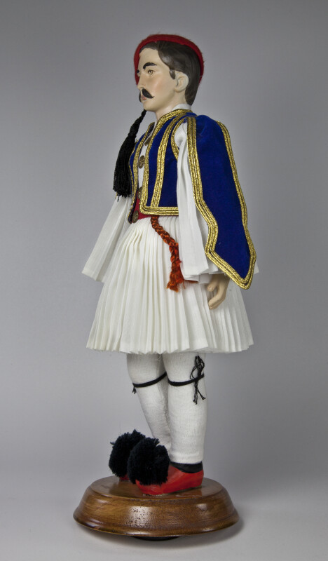 Greece Man Wearing National Costume of Blue Vest and Pleased Shirt and Skirt (Three Quarter View)