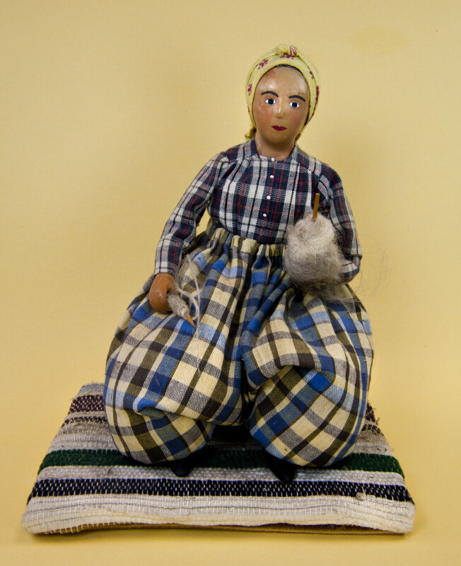 Greece Replica of Traditional Greek Woman Who is Spinning Wool with a Hand Spindle (Full View)