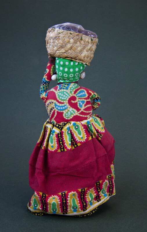 Grenada Fabric Figure of Woman with Basket of Spice (Back View)