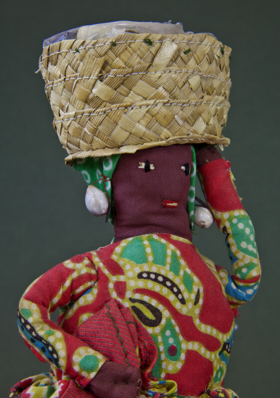 Grenada Lady with Basket of Spice on Her Head (Close Up)