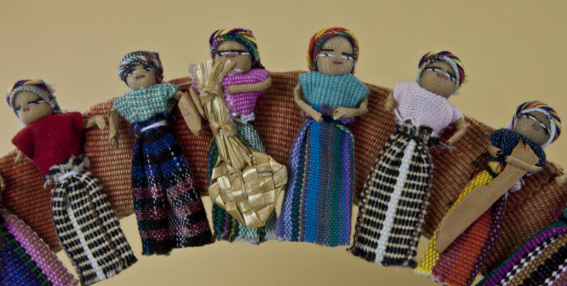 Guatemala Dolls in Worry Doll Wreath Holding Small Accessories (Partial View)
