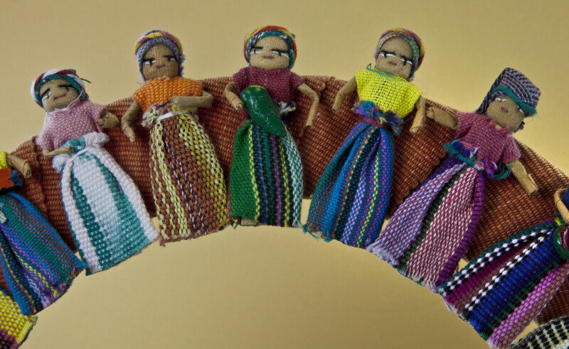 Guatemala Dolls in Worry Doll Wreath with Bright Dresses (Partial View)