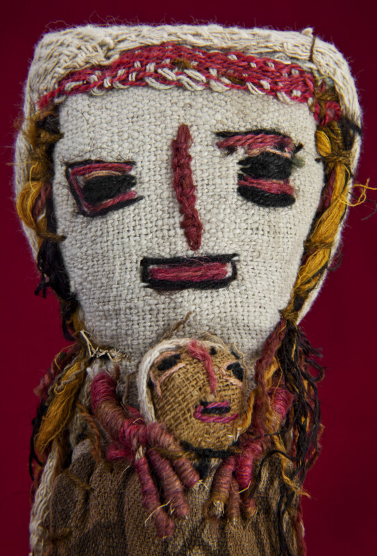 Guatemala Handcrafted Doll Made with Burlap and Fabric with Embroidered Face (Close Up)