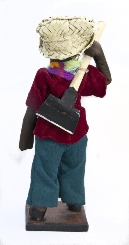 Haiti Handcrafted Man Handcrafted from Paper Mache and Holding a Wooden Hoe  (Back View)
