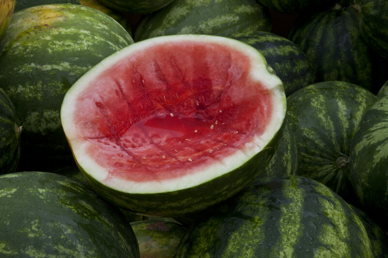 Half-Eaten Watermelon Stacked on Top of Other Watermelons