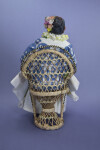 Hawaiian Handcrafted Woman with Flower Lei Sitting in Wicker Chair (Back View)
