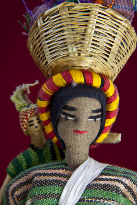 Honduras Fabric Doll with Embroidered Face Carrying Baby Made from Wire Covered Tape (Close Up)
