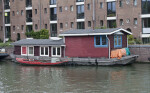Houseboat Moored on Side of Canal in Amsterdam