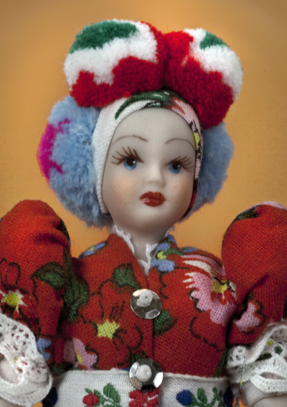 Hungary Female Doll in National Costume with PomPoms on Head (Close Up)
