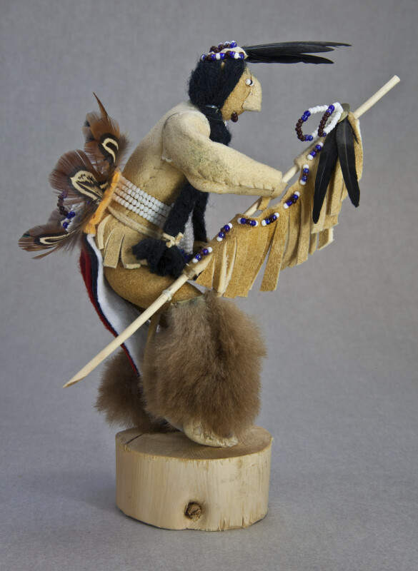 Idaho Male Native American Shoshone Warrior Doll Holding a Fringed and Beaded Staff (Side View)