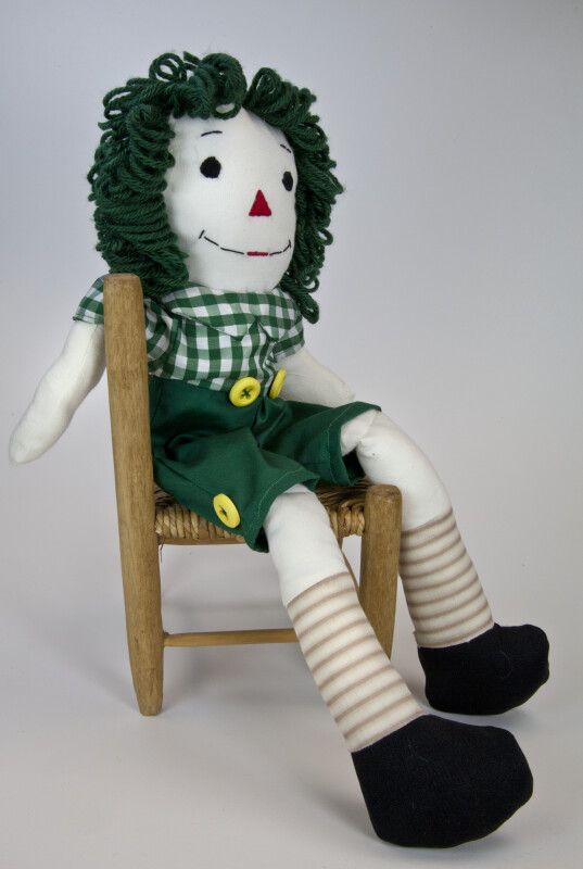 Indiana Raggedy Andy Doll Seated Sideways on a Wicker Chair (Full View)