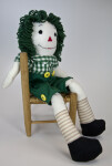 Illinois Raggedy Andy Doll Seated Sideways on a Wicker Chair (Full View)