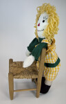 Indiana Raggedy Ann Doll Made with Fabric and Yarn Standing by Wicker Chair (Full View)