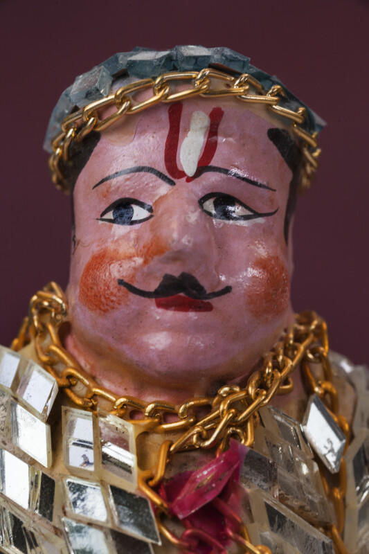 India Ceramic Man with Blue Cap Made from Mirrors and Hand Painted Face (Close Up)