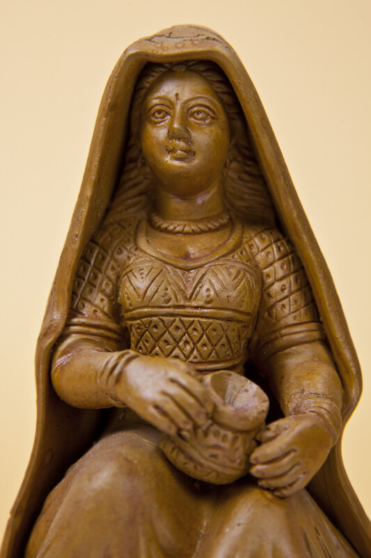 India Handcrafted Sculpture of Woman with Elegant Dress Holding Pot (Close Up)
