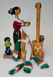 India Handcrafted Wood Lady with Large Scarf in India Standing at a Well (Close Up)