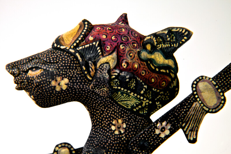 Indonesia Intricate Batik Designs on Shadow Puppet with Rods (Close Up)