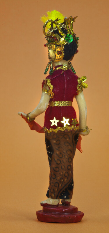Indonesia Woman Dressed in Bright Colors, Gold Trim, and Sequins (Back View)
