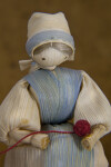 Iowa Female Doll Made from Corn Husks Holding a Ball of Yarn (Close Up)
