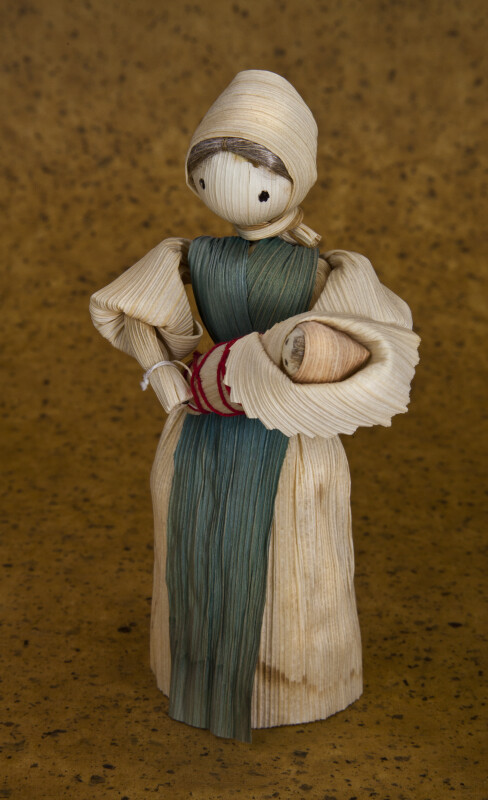 Iowa Handcrafted Cornhusk Woman Holding Baby  (Three Quarter View)