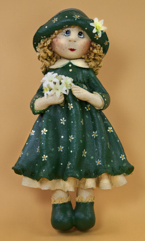 Ireland Lass Made from Dough Wearing Green Dress, Hat, and Shoes (Full View)