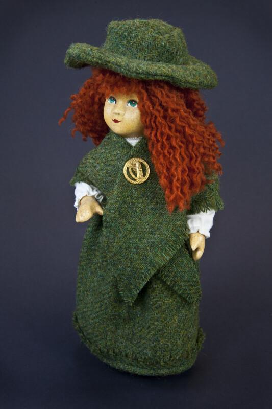 Irish Girl Handcrafted from Ceramic, Fabric, and Yarn (Three Quarter View)