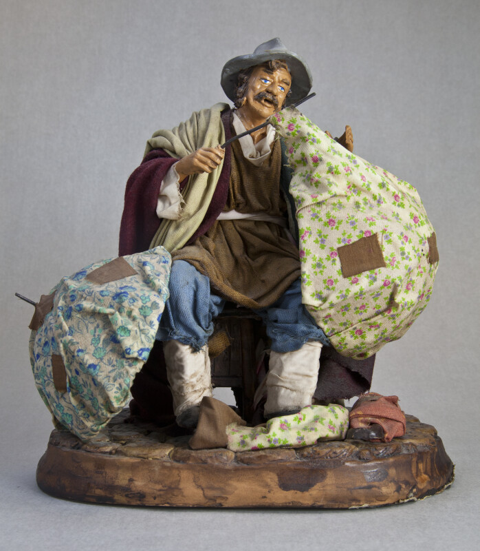 Italy Ceramic Figure of Man Fixing Umbrellas (Full View)