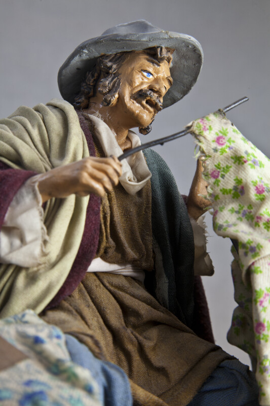 Italy Hand Painted Ceramic Man Fixing an Umbrella with a Wire Rod (Three Quarter Length)