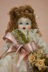 Italy Handcrafted Italian Lady Holding Bouquet of Artificial Flowers and Ribbons  (Close Up)