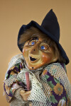 Italy Photo of Handcrafted Witch  Who is Flying on Wooden Broom (Close Up)