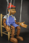 Italy Pinocchio  Jointed Marionette Sitting on Chair  (Side View)