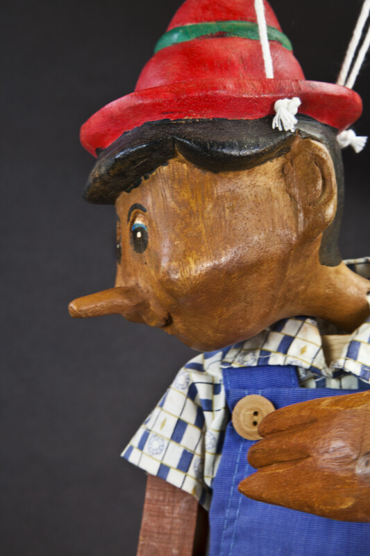 Italy Pinocchio Toy Puppet Marionette Sitting with Strings  (Close Up Profile)