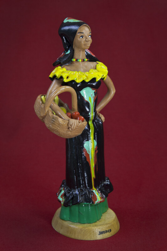 Jamaica Lady with Fruit Basket Created by Frazer's Ceramic in Kingston (Three Quarter View)
