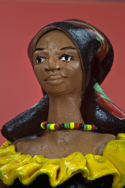 Jamaican Ceramic Woman with Colorful Bead Necklace, Head Scarf, and Ruffled Collar (Close Up)