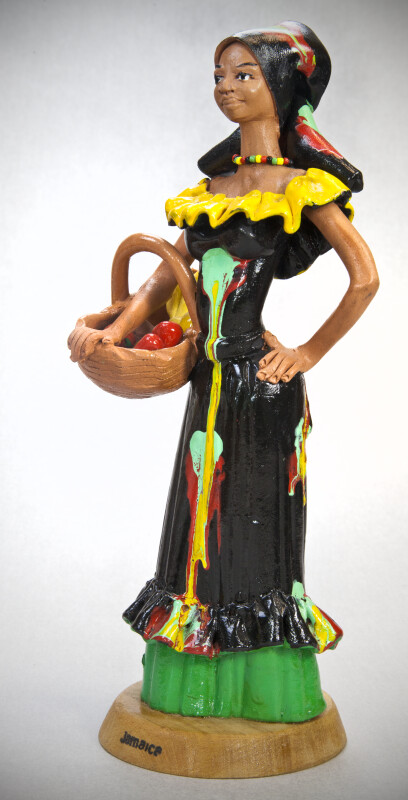 Jamaican Female Ceramic Figurine with Basket of Colorful Fruit (Three Quarter View)