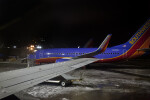 Jet Parked on Snowy Tarmac