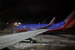 Jet Parked on Snowy Tarmac