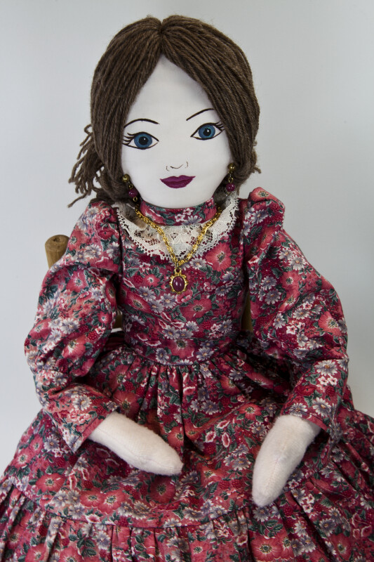 Kansas Female Doll with Yarn Hair, Red Stone Earrings and Necklace (Close Up)