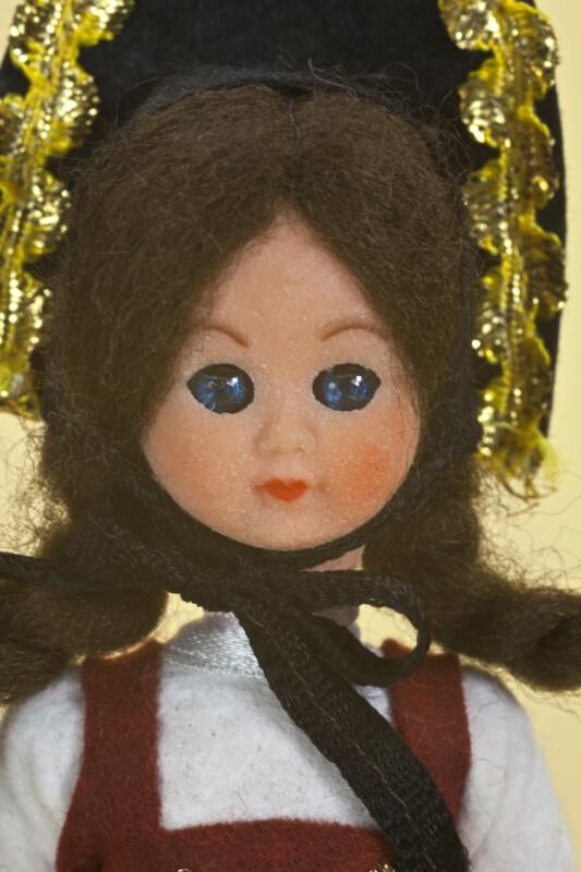 Liechtenstein Plastic Figure of Young Maiden  Wearing Traditional Black Felt Folk Bonnet (Close Up)