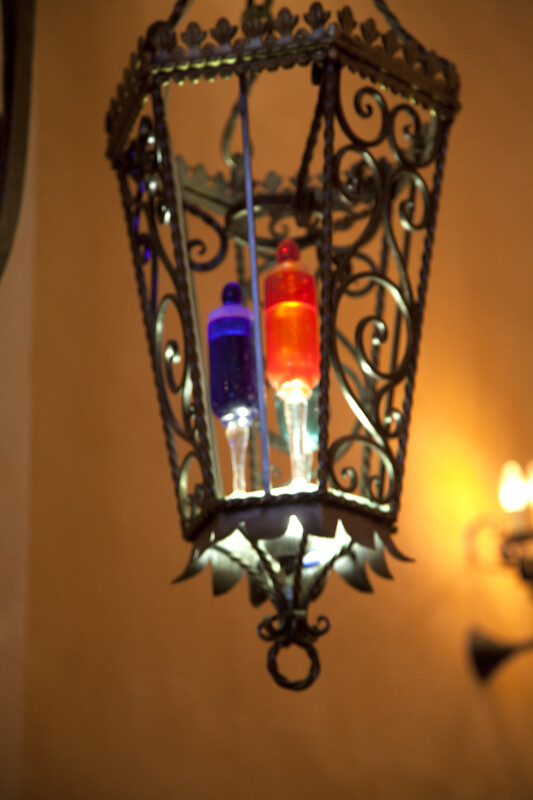 Light Fixture with Colored Bulbs at Mission Concepción