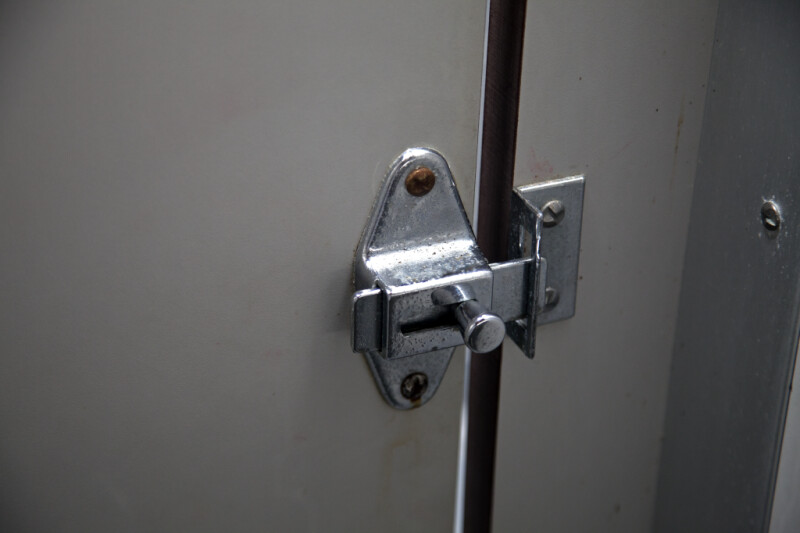 lock on the door of a stall in a public bathroom picture of the lock