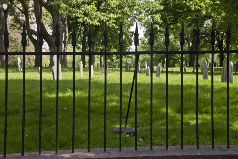 Looking through a Fence at Tablet Headstones