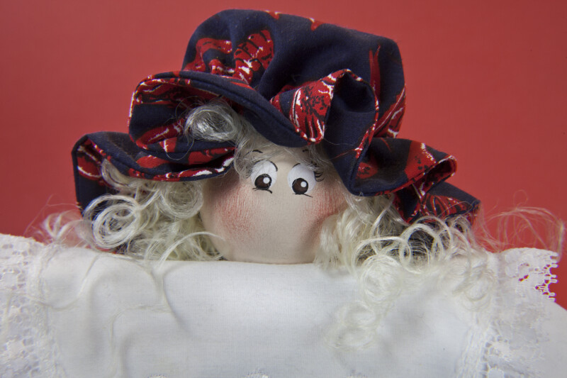 Louisiana Doll with Wood Bead for Head, Print Cap, and Synthetic Hair (Close Up)