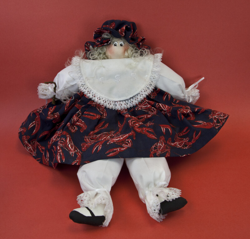 Louisiana Girl Doll Made from Wood and Stuffed Material Wearing a Cotton Dress and Pantaloons (Full View)