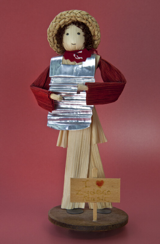 Louisiana Handcrafted Doll Made from Cornhusks and Wearing a Rub Board for Zydeco Music (Full View)
