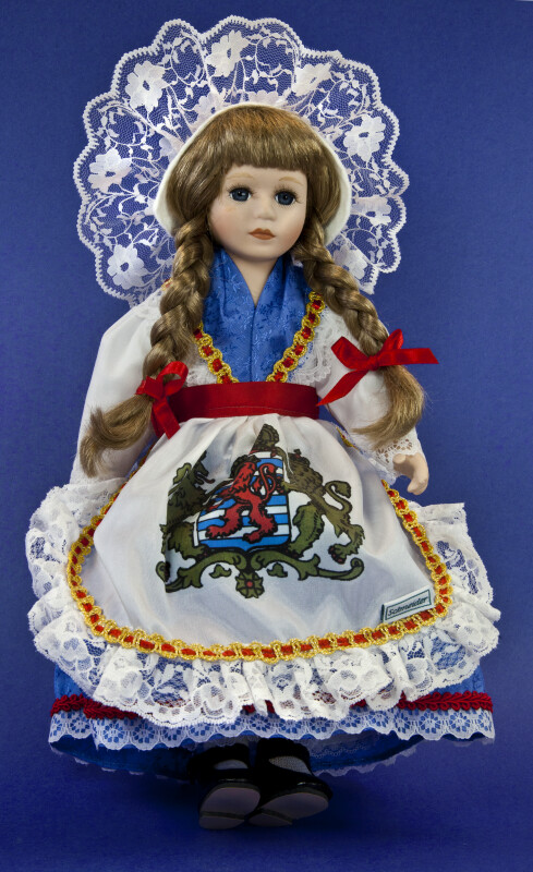 Luxembourg Doll Made by Schneider with Bulgarian Coat of Arms on Apron (Full View)