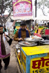 Man Serving Food in the Market