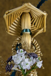 Manitoba, Canada - Faceless Female Figurine Made from Wheat Holding Bouquet of Artificial Flowers (Close Up)