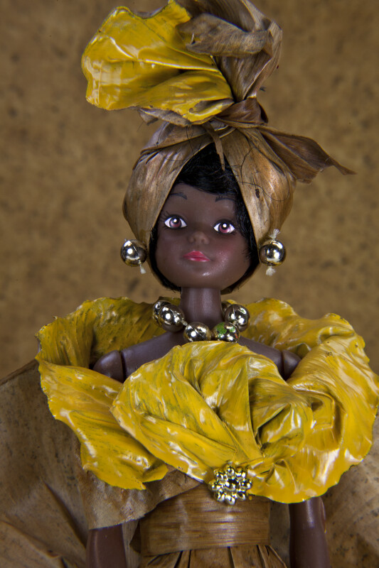 Martinique Banana Leaf Doll with Head Scarf, Gold Necklace and Earrings (Close Up)