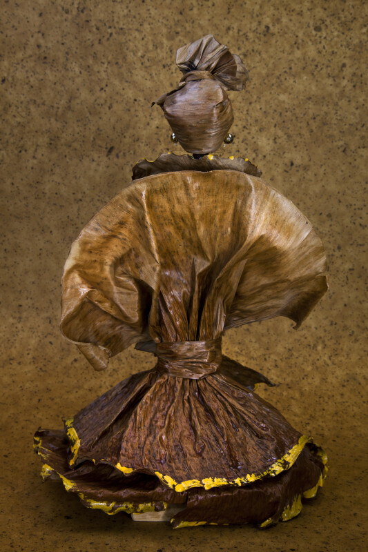 Martinique Doll Made from Plastic Wearing Banana Leaf Dress and Head Scarf (Back View)